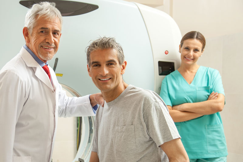 Doctor with patient and nurse in front of MRI